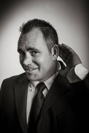 40 years old: Caucasian businessman 40 years old isolated on a grey background, black and white image