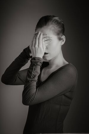 expressing negativity: Attractive caucasian woman in her 30 isolated on a grey background, black and white image Stock Photo
