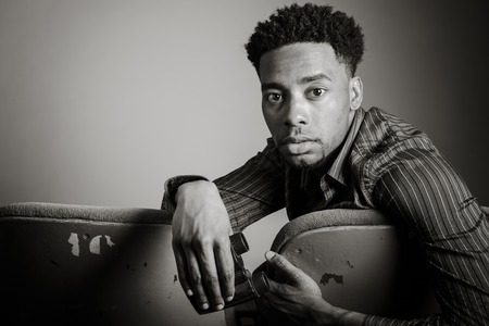 afroamerican: Attractive afro-american man posing in a  studio isolated on a background, black and white image Stock Photo