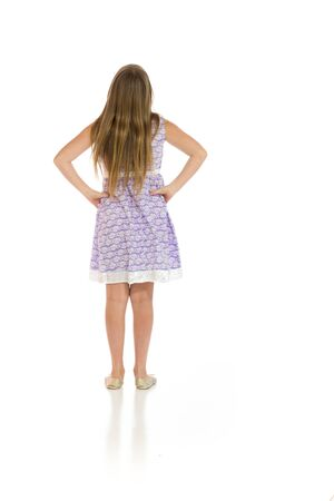 well dressed girl: Model isolated showing her back Stock Photo