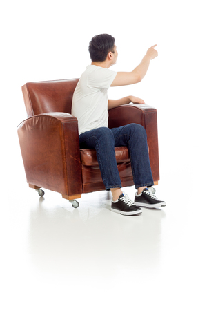 sit: Model isolated back pointing Stock Photo