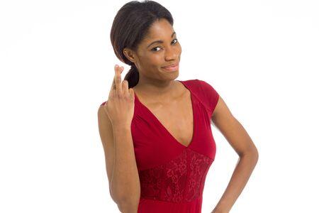 fingers crossed: Model fingers crossed wishing lucky Stock Photo