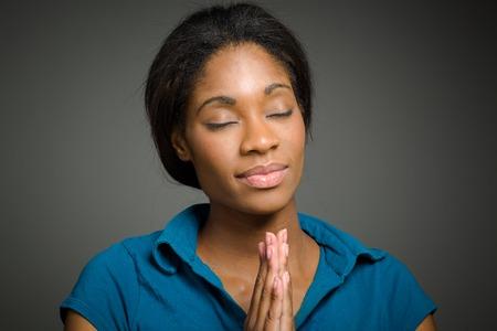 Model isolated praying Stockfoto