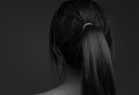naked girl black hair: Model isolated showing her back Stock Photo