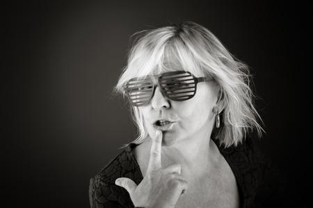 finger on lips: model isolated with finger on lips secret Stock Photo