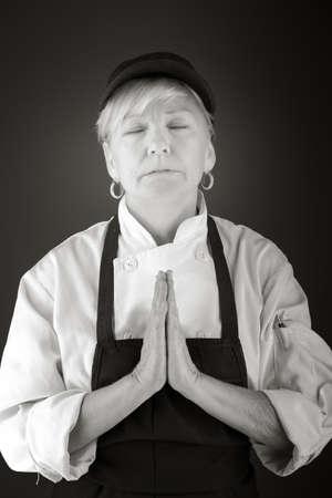 wishing: model isolated on plain background praying wishing Stock Photo
