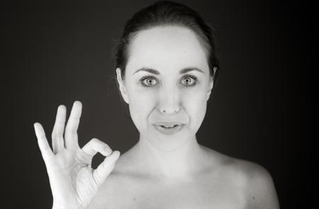 model isolated on plain background hand gesture ok sign Stockfoto
