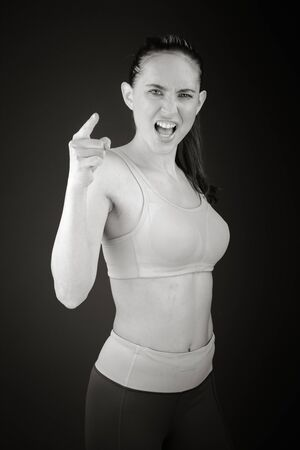 Model isolated on plain nagging scolding with finger