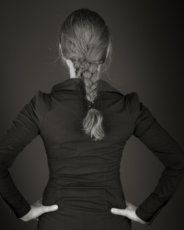 model isolated on plain background back hands on hips photo