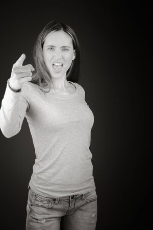 nagging: model isolated on plain background nagging scolding with finger Stock Photo
