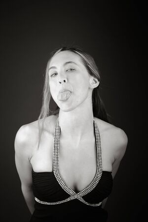 model isolated on plain background face sticking tongue out Stock Photo
