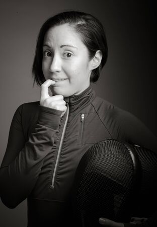 sportsperson: Female fencer biting nail