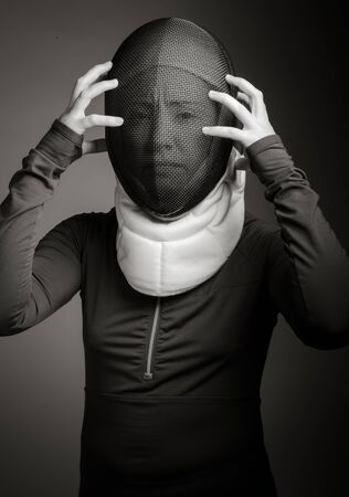 Female fencer in fencing mask looking frustrated Imagens