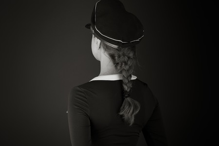 looking behind: model isolated on plain background back looking behind Stock Photo