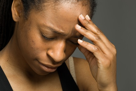 woman close up: Model isolated with headache