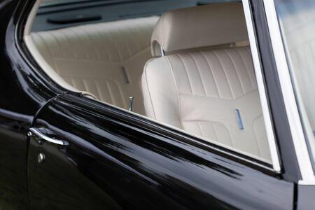 Car door lock pin of a black shiny classic vintage car