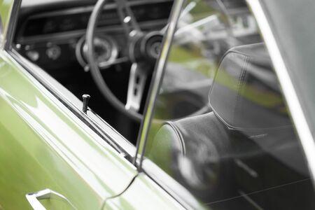 car door: Car door lock pin of a green shiny classic vintage car Stock Photo