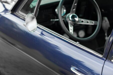shiny car: Wing mirror of a blue shiny classic vintage car Stock Photo