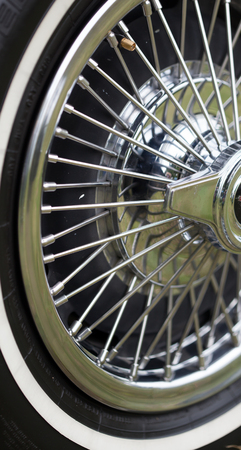 spoke: Close-up of spoke wheel of a classic vintage car