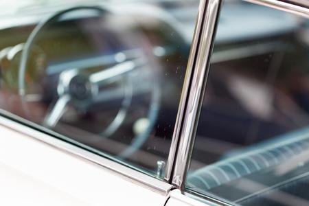 shiny car: Close-up of car door lock pin of a white shiny classic vintage car