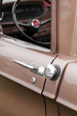 shiny car: Close-up of car handle of a brown shiny classic vintage car
