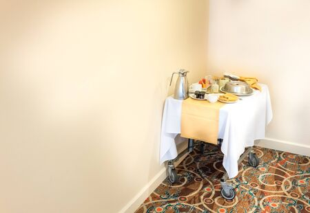 Food serving cart with breakfast in the corner of hotel room, Trinidad, Trinidad And Tobago