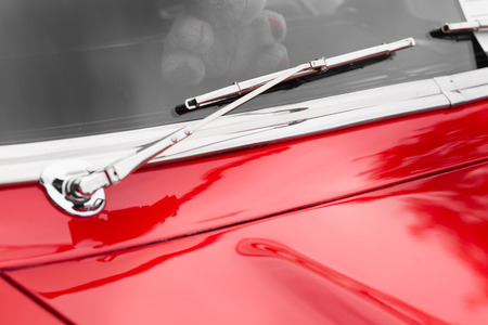 windscreen wiper: Close-up of windscreen wiper of a red shiny classic vintage car Stock Photo
