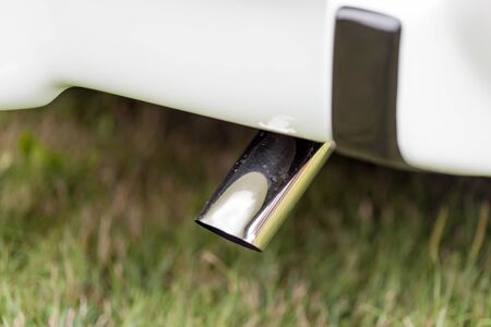 exhaust pipe: Close-up of exhaust pipe of a white classic vintage car Stock Photo