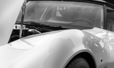 shiny car: Open bonnet of a white shiny classic vintage car Stock Photo