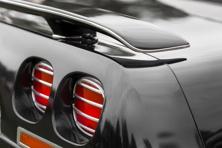 shiny car: Close-up of red tail lights of a black shiny classic vintage car