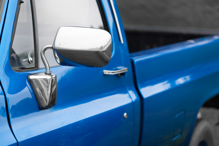 shiny car: Close-up of wing mirror of a blue shiny classic vintage car