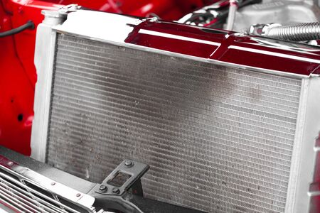 grille: Close-up of radiator grille of red vintage car