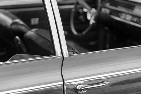 shiny car: Close-up of car door lock pin of a grey shiny classic vintage car