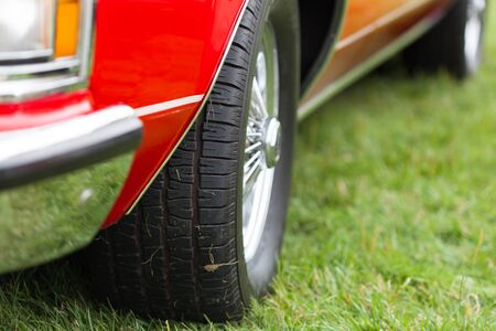 shiny car: Close-up of tyre of a red shiny classic vintage car