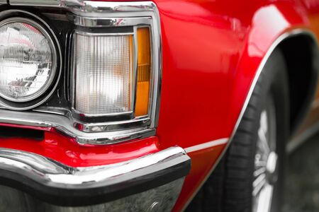 shiny car: Close-up of right headlights of a red shiny classic vintage car
