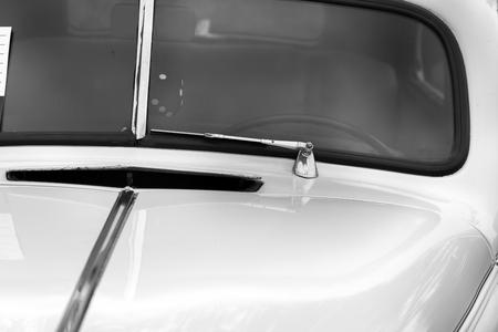 shiny car: Windscreen wiper of a white shiny classic vintage car