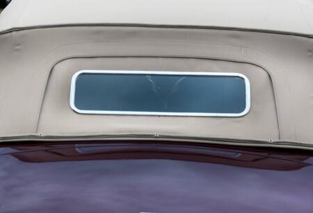 shiny car: Window of a purple convertible shiny classic vintage car