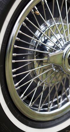 spoke: Close-up of spoke wheel of a classic vintage car