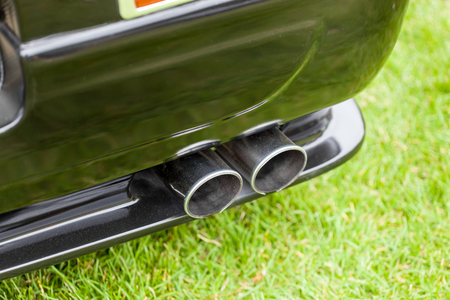 shiny car: Close-up of exhaust pipes of a black shiny classic vintage car