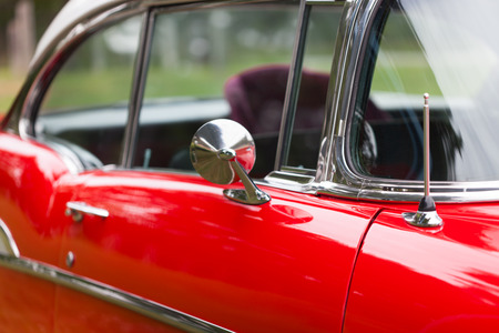 shiny car: Close-up of wing mirror of a red shiny classic vintage car