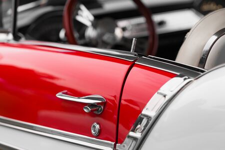 shiny car: Car handle of a red shiny classic vintage car Stock Photo