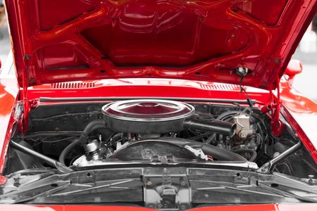 engine bonnet: Open bonnet of a red classic vintage car Stock Photo