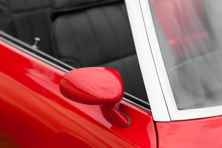 shiny car: Close-up of red wing mirror of a shiny classic convertible vintage car