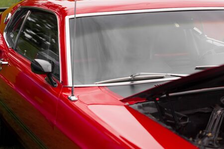 shiny car: Wing mirror of a red shiny classic vintage car Stock Photo
