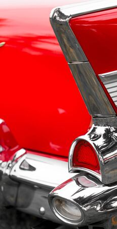 tail light: Close-up of tail light of a red shiny classic vintage car