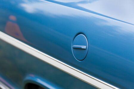 shiny car: Full frame shot of petrol tank of a blue shiny classic vintage car Stock Photo