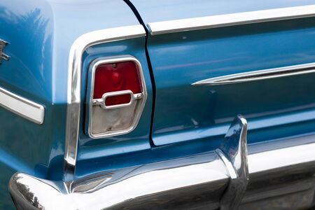 tail light: Close-up of right tail light of a blue shiny classic vintage car