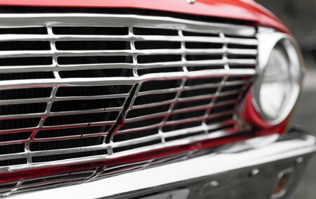 grille: Close-up of radiator grille of a red classic vintage car