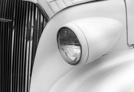 shiny car: Close-up of right headlights of a white shiny classic vintage car