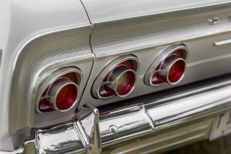 Close-up of tail lights of a white classic vintage car Stock Photo